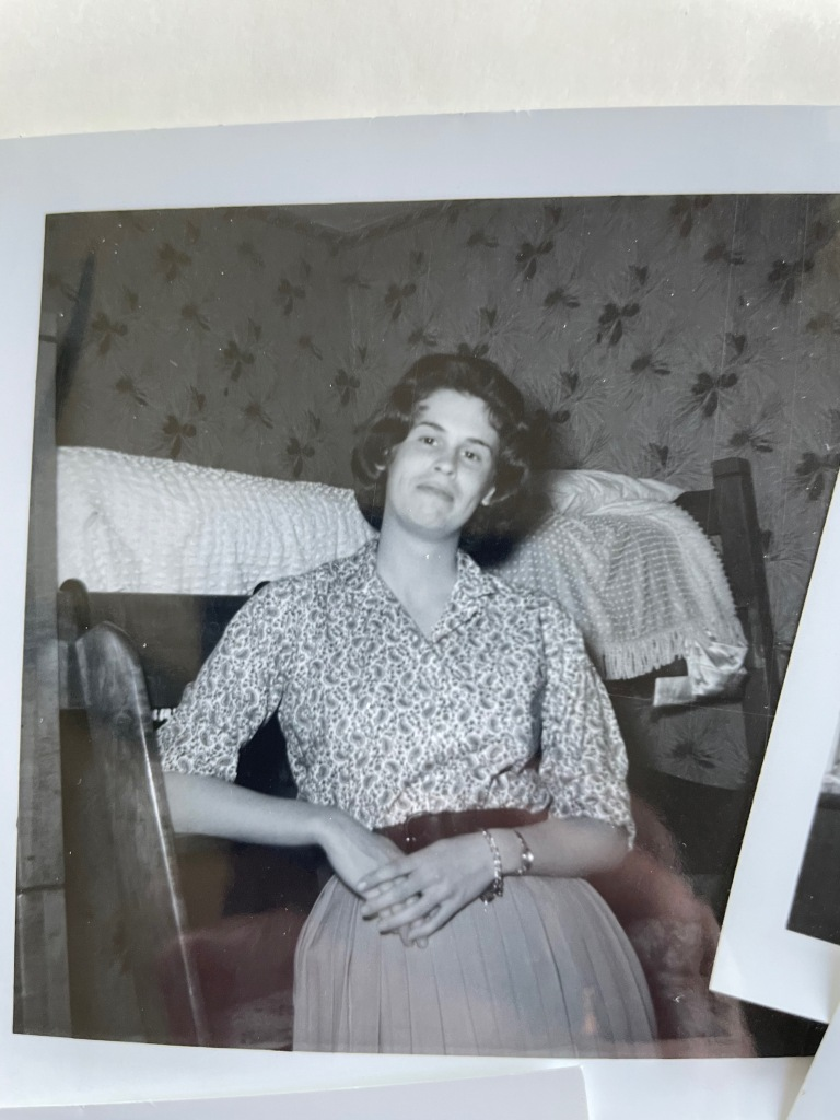 My mom in college, standing in front of her bunk bed at the sorority house.